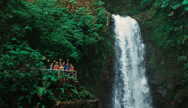 Travelers in Costa Rica enjoying the beautiful waterfalls