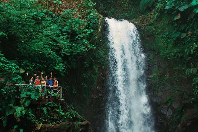 Travelers in Costa Rica enjoying the beatiful waterfalls at La Paz